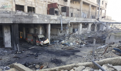 Syria, destroyed building and ambulance
