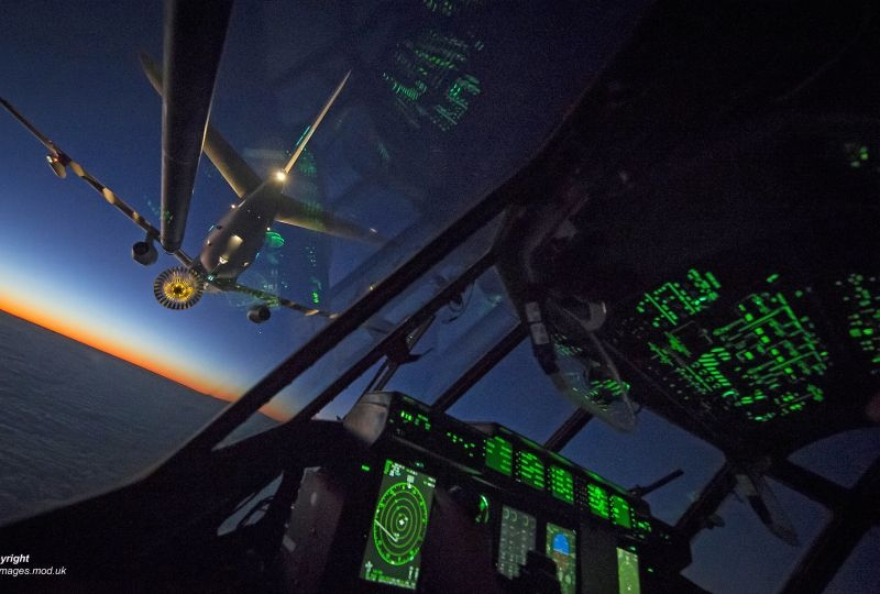 Pictured is the interior of a Royal Air Force C130J Hercules conducting low-light refuelling with an Airbus Voyager Airtanker during a routine training sortie over the West Coast of England.