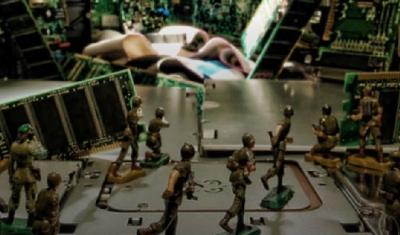 Toy soldiers siulating a fight in a context of electronic computer circuits
